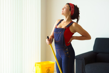 Portrait Woman Doing Chores Cleaning Floor With Backache