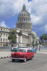 Red american car  in front of Capitolio, Havana, Cuba
