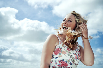Laughing woman in a gust of wind.