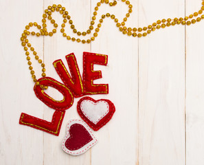 Red letters love and textile hearts.