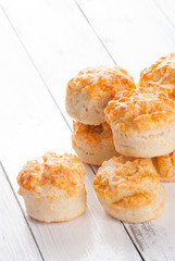 Home made cheese scones on white wood background
