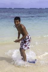 teenage boy on skim board