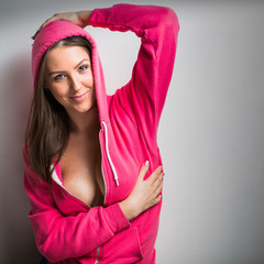 Seductive Young Woman Posing in pink hoodie