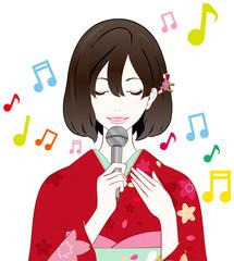 着物の女性 歌う