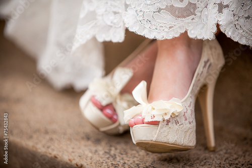 canvas print picture Beautiful white creamy lacy wedding shoes