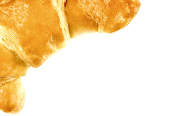 Background texture of freshly baked croissant with copyspace
