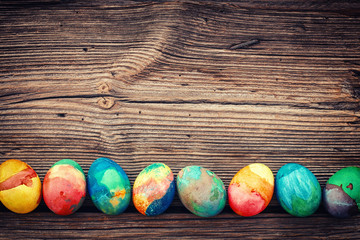 Easter colored eggs on old wooden boards