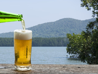 Enjoy beer with sea landscape.