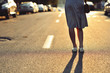 Closeup of young woman legs on the road