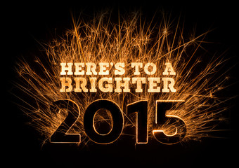Here's To A Brighter 2015 greeting on dark background.