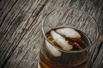 Glass of Whiskey on Rustic Wood Bar