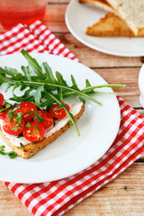 Delicious bruschetta with tomato and cheese on a plate