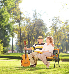 Mature man sitting with his wife in park