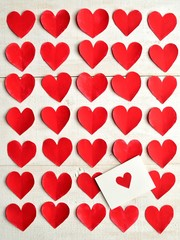 Red heart message card on red heart background