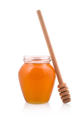 Honey jar and wooden spoon