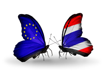 Two butterflies with flags EU and Thailand