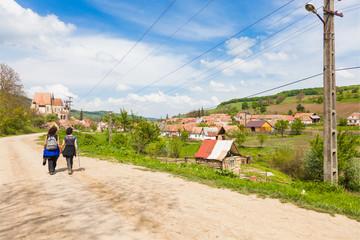 Hikers on path near village Transylvania