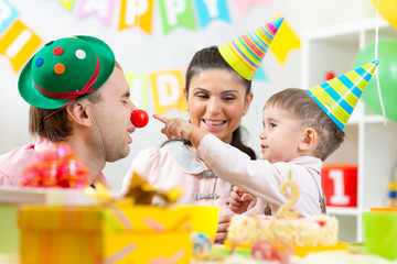 parents have fun celebrating birthday of his son