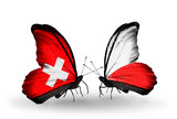 Two butterflies with flags Switzerland and Poland