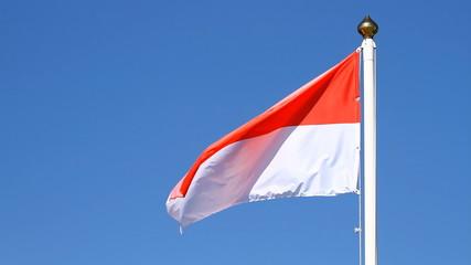 Flag of Monaco on a blue sky