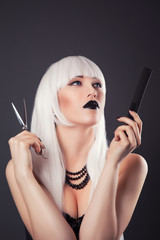 beautiful blonde woman with black make-up and accessories posing