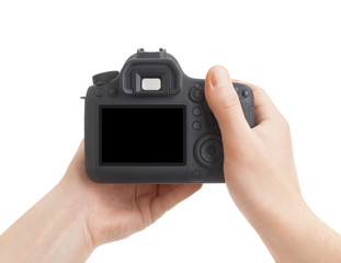 Camera in hand on white background