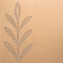 Leaves cut out on a corrugated cardboard