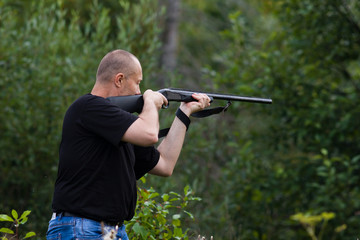 the shooter aiming from a gun at target