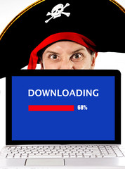 man in pirate hat with Computer files illegal download