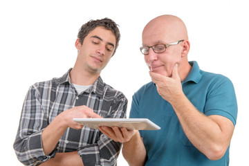 a son explains to his father the digital tablet