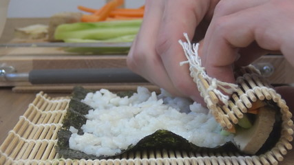 Sushi roll making japanese food