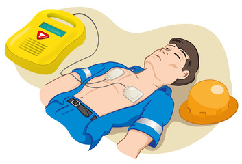 first aid employee with portable defibrillator