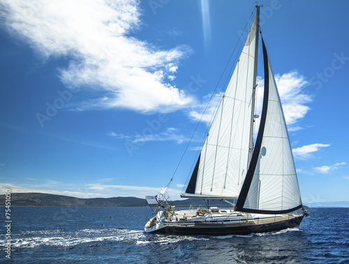 Sailing in the wind through the waves. Sailing. Luxury yachts. - 75451050