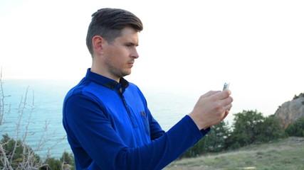 Man using  camera app on smartphone