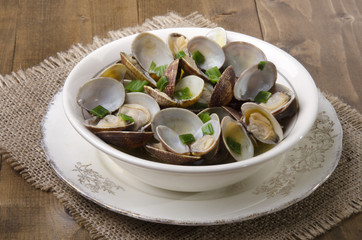 clams with wine sauce in a bowl