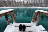 Winter swimming in blue lake
