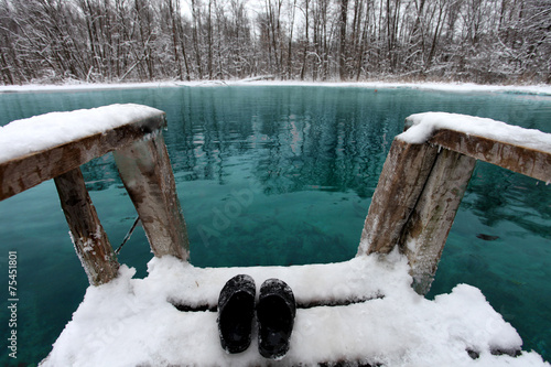 Winter swimming in blue lake - 75451801