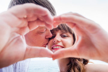 mature couple with love sign