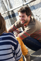 Happy young man having a conversation with woman
