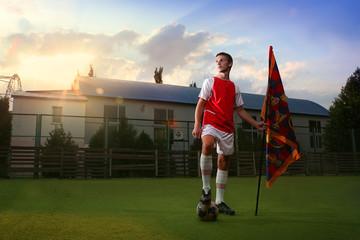 Portrait of soccer player with flag of winner. Street soccer.