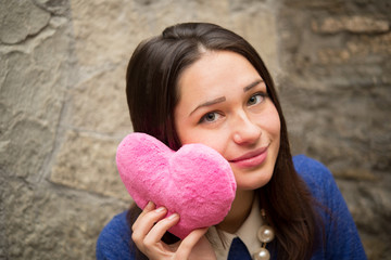 beautiful girl with plush pink heart