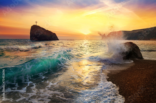 beautiful sunset on the sea with a wave and stone - 75453696