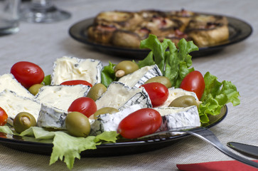French cheese, stuffed olives and cherry tomatoes