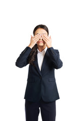 Full length young businesswoman covering eyes with hands