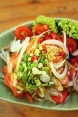 Fresh salmon salad with spices - Japanese food.