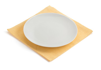 plate at napkin on white
