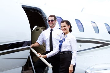 Pilot and stewardess stop before entering jet