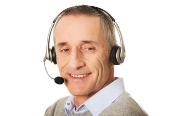 Portrait of call center man wearing a headset
