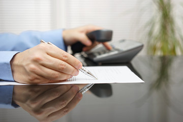 businessman is calling for advice when reading  contract