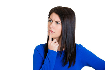 Young woman, finger on lips, looking confused surprised